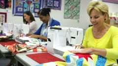 Group Of Women Using Electric Machines In Sewing Class Stock Footage