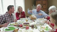 Stock Video Footage of Grandfather Carving Turkey At Family Thanksgiving Meal