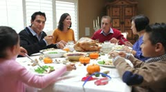 Multi Generation Family Enjoying Thanksgiving Meal - stock footage