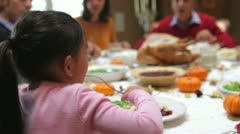 Young Girl Enjoying Family Thanksgiving Dinner Stock Footage