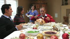 Grandfather Carving Turkey At Family Thanksgiving Meal Stock Footage
