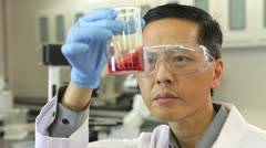 Male Scientist Working In Laboratory Stock Footage