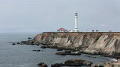 Calm ocean waves Historic Point Arena Lighthouse California coast HD 6212 Stock Footage