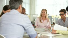 Team Meeting Around Table In Creative Office - stock footage