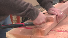 Man chiseling wood Stock Footage