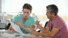 Two Men Using Tablet Computer In Creative Office - stock footage