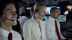 Security personnel working in system control room. - stock footage