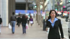 Businesswoman In Street Holding Takeaway Coffee Stock Footage