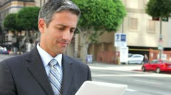 Businessman Working On Tablet Computer Outside Stock Footage