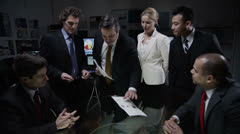 Innovative business team discuss ideas in a late night meeting Stock Footage