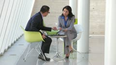 Two Business People Having Informal Meeting Stock Footage