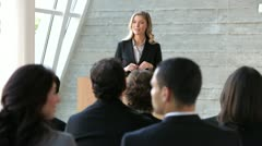 Businesswoman Giving Presentation At Conference Stock Footage