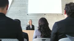 Businesswoman Giving Presentation At Conference - stock footage