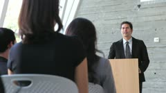 Businessman Giving Presentation At Conference - stock footage