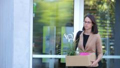 Redundant Businesswoman Leaving Office With Box - stock footage