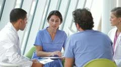 Medical Staff Meeting To Review Patient Notes Stock Footage