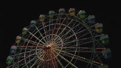 Low angle shot of a Ferris Wheel at Night Stock Footage