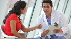 Doctor Discussing Notes With Female Patient Stock Footage