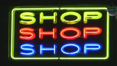 Neon shop sign at night Stock Footage
