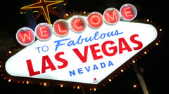 Welcome to Las Vegas sign hand held twist 30p Stock Footage