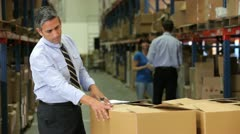 Businessman Checking Box Detail With Clipboard Stock Footage