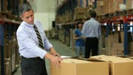 Stock Video Footage of Businessman Checking Box Detail With Clipboard
