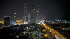 Elevated illuminated night view of Media and Internet city, Dubai, UAE, Time Stock Footage