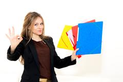 Woman with ok gesture and folder Stock Photos