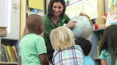 Teacher Showing Group Of Elementary Age Schoolchildren Globe - stock footage