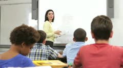 Teacher Asking Class Of Pupils Question - stock footage
