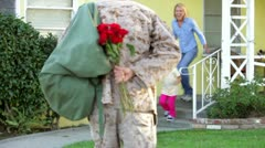 Family Welcoming Husband Home On Army Leave Stock Footage