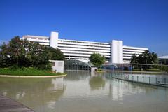 white building reflex on pool. - stock photo