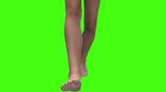 Human legs walking toward camera green screen Stock Footage