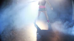Young cute girl makes a fabulous crane up dance with smoke Stock Footage