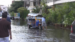 Washing a Tuktuk With Flood Water p175 Stock Footage