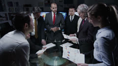 Innovative business team discuss ideas in a late night meeting - stock footage