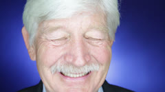 An old Geezer blink his bluish eyes thinks something and smiles Stock Footage