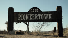 Pioneertown, CA town sign, front angle, Old West Stock Footage