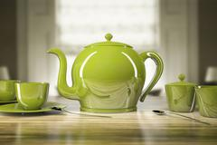 Stock Illustration of green teapot and teacups