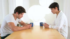 Couple distracted by technology Stock Footage