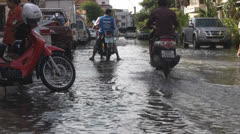 Motor Cycles in a Flooded Road p171 Stock Footage