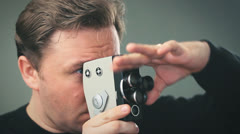 The cameraman shoots with a small film movie camera 001 - stock footage