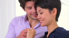 Mixed race couple happily engaged - stock footage