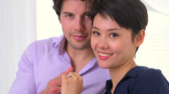 Portrait of happily engaged interracial couple Stock Footage