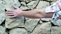 Man hands touching stone wall, steadycam shot Stock Footage