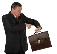 Stock Photo of older businessman with briefcase isolated on white background