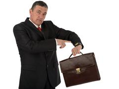 Older businessman with briefcase isolated on white background Stock Photos