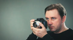 Photographer takes shots, setting manual focus 003 Stock Footage