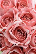 close up bouquet of pink fabric roses. - stock photo