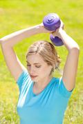 Stock Photo of young sport woman lift weight